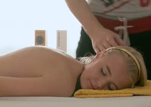 Stunning booty of a golden-haired Russian college girl on the massage table