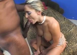 Trashy fake titted blonde Lori Lust enjoys a estimated black boning