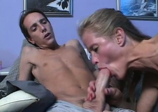 Golden-haired milf gives a youthful stud a great blowjob and rides his hard cock