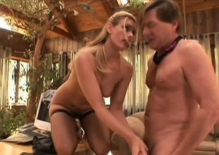 Blond milf in black stockings Darryl Hanah gives an awesome footjob