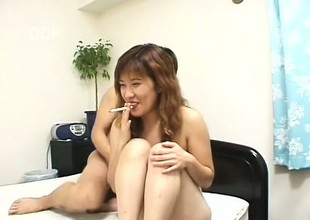 Asian cutie Mako gets her lovely snatch eaten out and fucked on the sofa