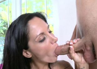 Milf with large natural tits is seen placing her hungry mouth on a cock