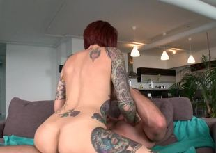 Inked redhead darling riding a big dick with so much pleasure