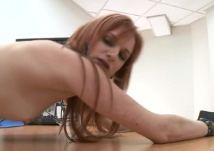 A redhead is showing us how good she's at handling a large dick