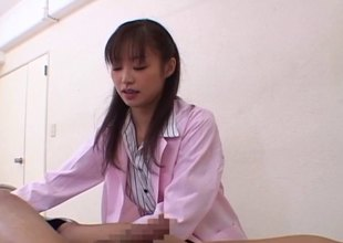 Clothed Japanese bimbo in hose gets a good fingering