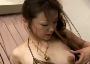 Natural cutie from Japan uses pink egg love sex toy to tease her cunt