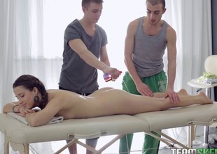 Two guys give her a relaxing massage then they double team her