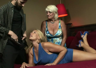 Dana Hayes and Melanie Monroe give head to a hunk