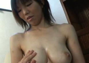 Ugly Japanese whore exposing huge natural jugs