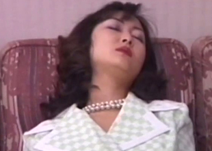Classy Japanese MILF playing with her muff