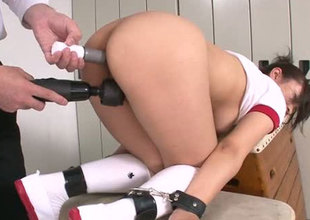 Seductive Japanese babe getting her shaved pussy toy fucked