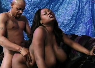 Ebon babe with giant titties takes some coarse doggystyle sex