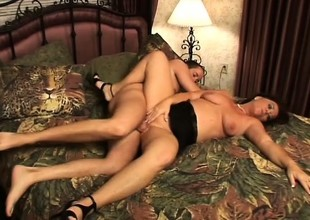 Chubby housewife in a black dress shakes her large butt on her dude