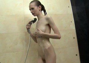 Skinny juvenile brunette hair Bonnie shows off her tight slit in the shower