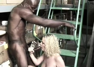 Pretty juvenile golden-haired gets pounded by two dark-skinned studs in the warehouse