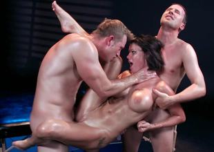 A beauty with a blindfold is getting fucked by two guys