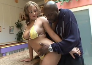 Busty slut Trina Michaels is back and ready to suck on some fat cock...and it just so happens that this time the cock is going to be Lex Steele's! Watch as Trina takes his massive Negro meat member right in between her tight pink flaps in advance of Lex blows a